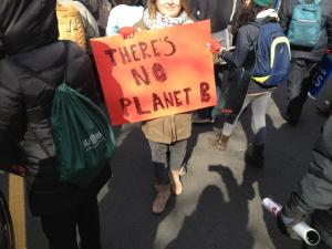 Holding my sign amidst the crowd